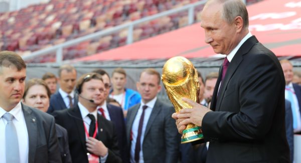 Vladimir Putin holding the FIFA World Cup 2018
