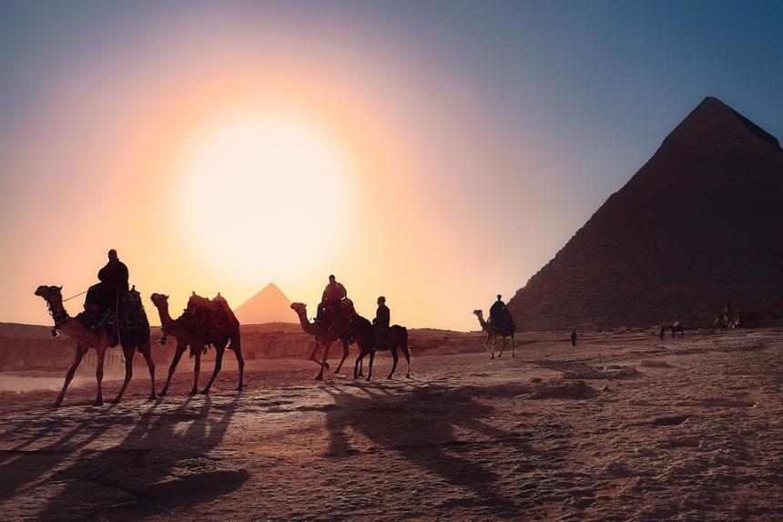 Camel riding in desert, Cairo, Egypt